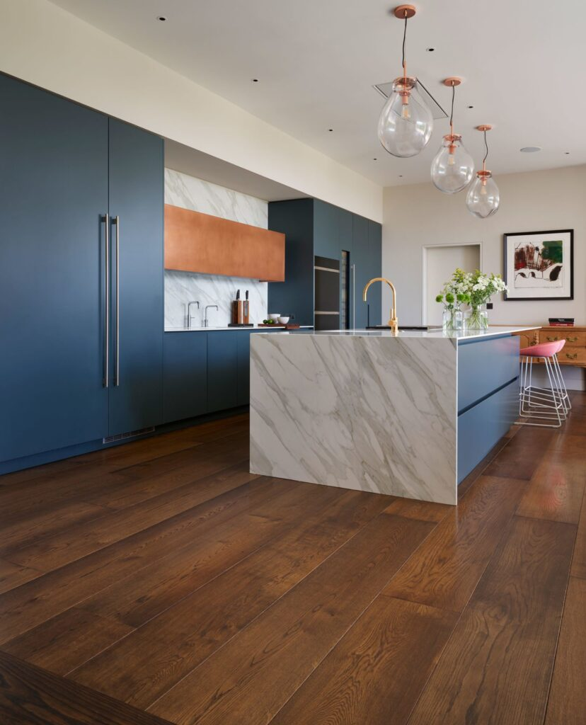 open plan kitchen showing micro bevelled oak flooring planks in a mid-dark finish colour.