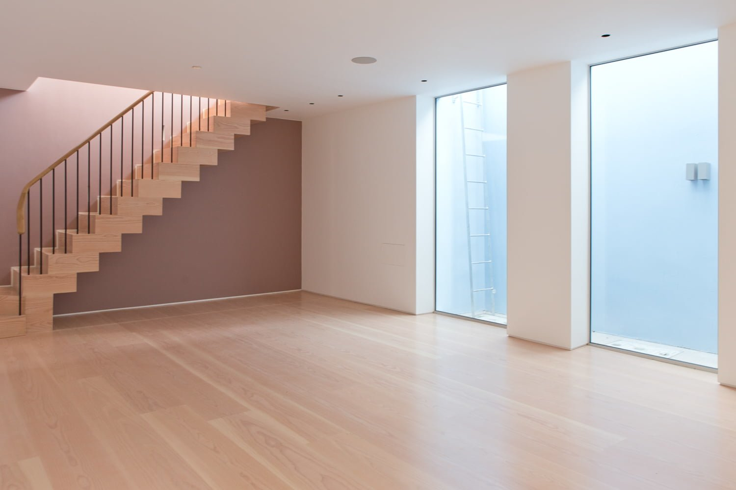 Airy interior with stairs and douglas fir flooring