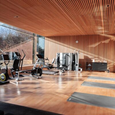 Square edged lacquered bespoke engineered oak wood flooring in private gym
