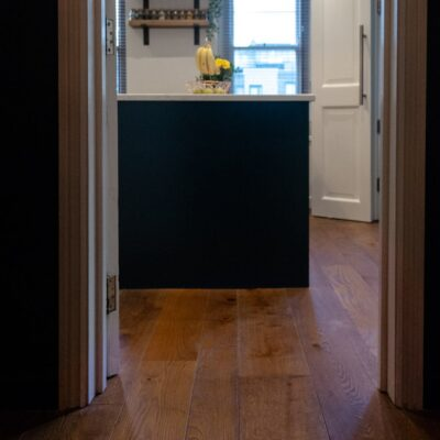 Chaunceys oak engineered flooring in brushed Burnt Umber finish at Redland Refurb project hallway
