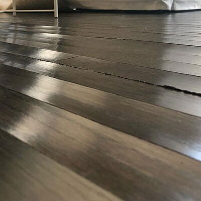 dark hardwood floorboards cupping